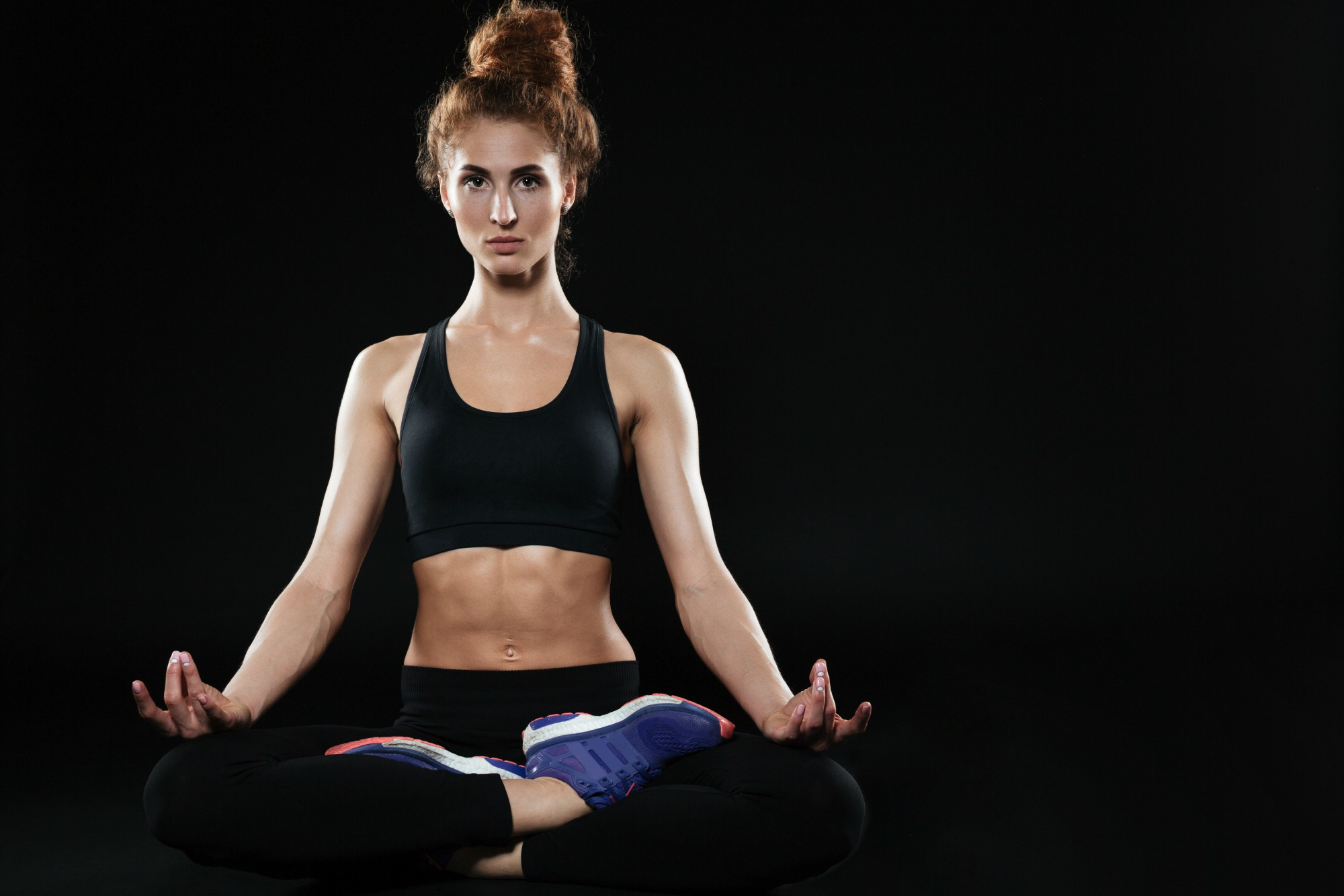 Meditate woman sitting in lotus pose