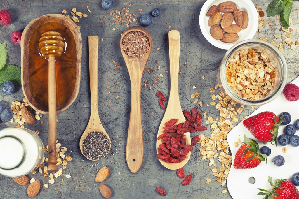 Healthy Breakfast set with granola, superfoods, almond milk and