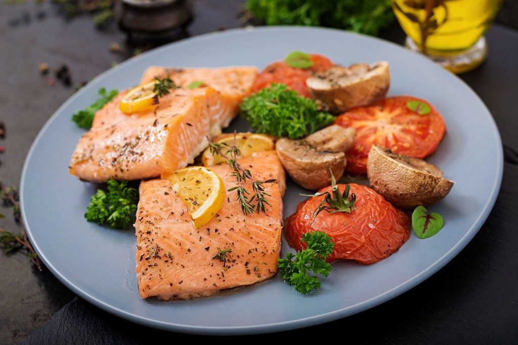Actual Lifestyle salmon fish fillet with tomatoes, mushrooms and spices. Diet menu.